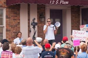 Doc Thompson speaks in Front of Rep. John Boehner's office.